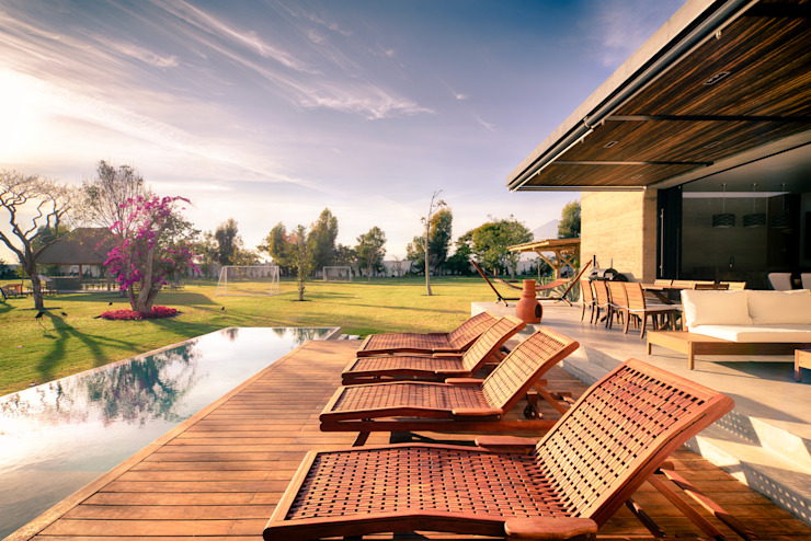 Terraza y jardín QG Balcones y terrazas modernos de Taller Tlaiye Moderno