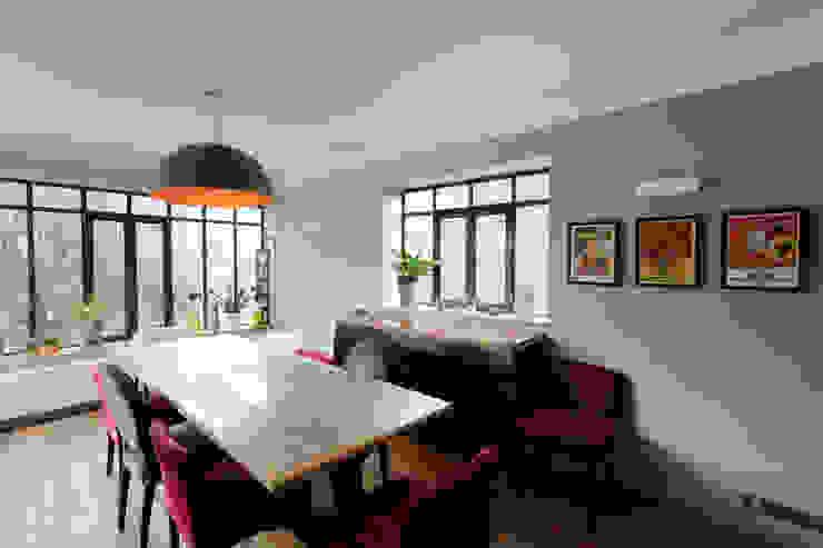 Salle à manger:  de style  par AC architecture