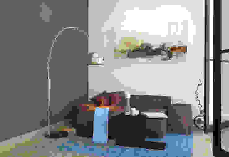 lounge design with a curve sofa توسط Rhythm And Emphasis Design Studio