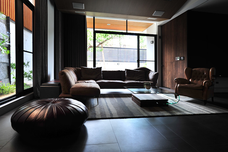 Salas multimedia de estilo minimalista de 黃耀德建築師事務所 Adermark Design Studio Minimalista
