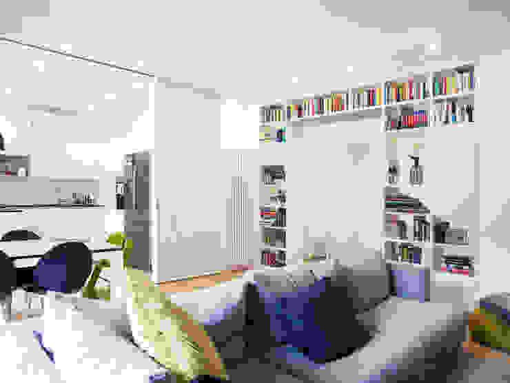 soggiorno con pannelli scorrevoli - pannelli aperti studio di progettazione architetto caterina martini Soggiorno moderno