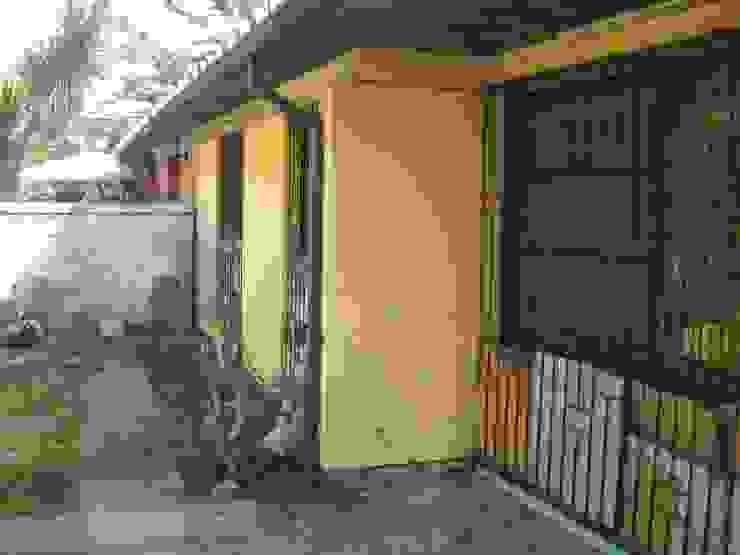 Fachada trasera antigua DIEGO ALARCÓN & MANUEL RUBIO ARQUITECTOS LIMITADA Casas unifamiliares