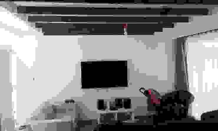 Interior Nuevo Living DIEGO ALARCÓN & MANUEL RUBIO ARQUITECTOS LIMITADA Livings de estilo moderno