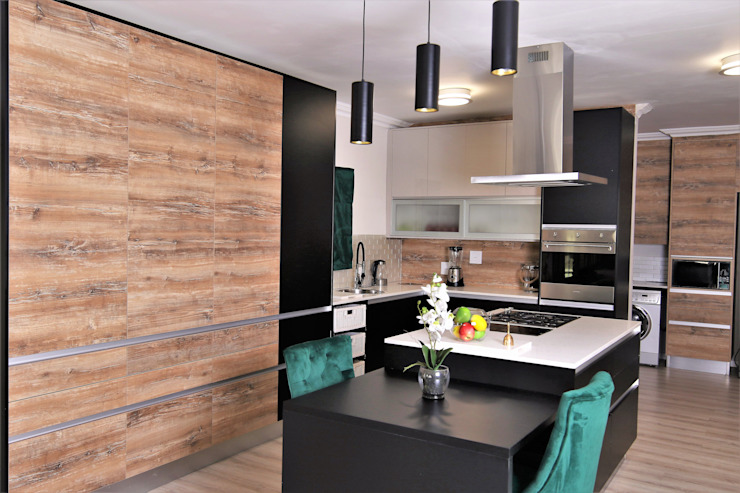 Kitchen by Motama Interiors and Exteriors Modern Engineered Wood Transparent