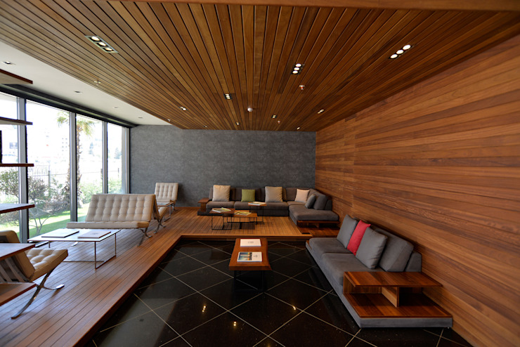Cladding:  Walls & flooring by Motama Interiors and Exteriors,