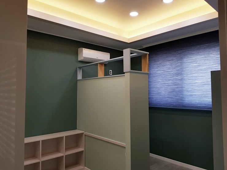 GN건축사사무소 Modern nursery/kids room Chipboard Green