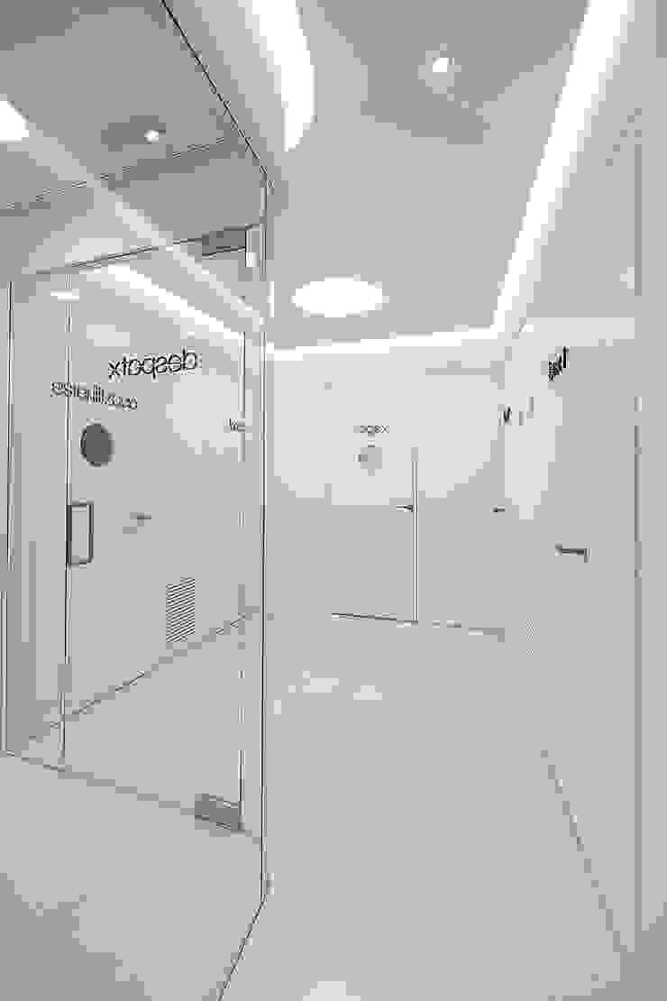 Clínica dental Acevedo YLAB Arquitectos Clínicas de estilo minimalista