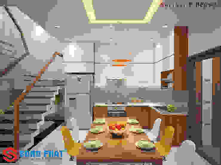 Màu vàng được thêm vào làm điểm nhấn cho căn phòng. Phòng ăn phong cách hiện đại bởi Công ty TNHH TK XD Song Phát Hiện đại Đá hoa