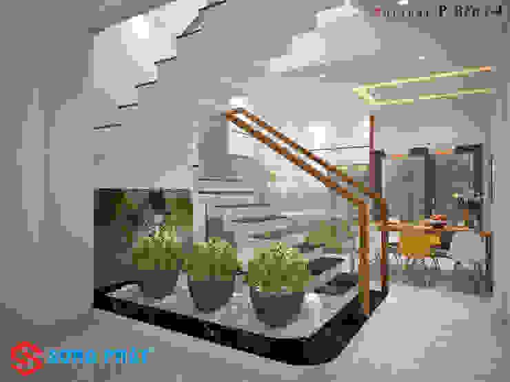 Tiểu cảnh trong nhà vừa là điểm nhấn vừa tạo sinh khí cho ngôi nhà bởi Công ty TNHH TK XD Song Phát Hiện đại Đồng / Đồng / Đồng thau