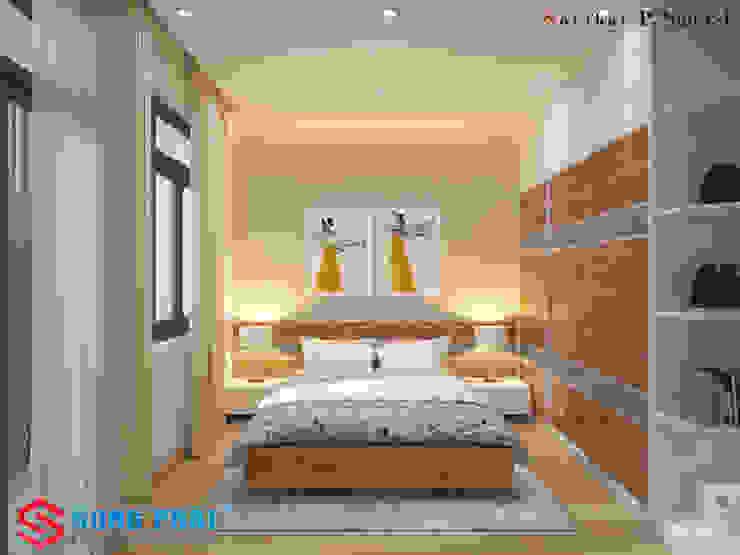 Các vật liệu chính được sử dụng là gỗ và đá tự nhiên. Phòng ngủ phong cách hiện đại bởi Công ty TNHH TK XD Song Phát Hiện đại Đồng / Đồng / Đồng thau