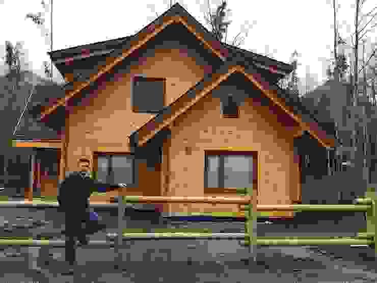 Casa de madera en Pucón, Chile. de Patagonia Log Homes - Arquitectos - Neuquén Escandinavo Madera Acabado en madera