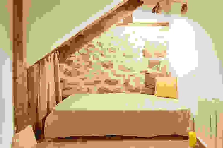 Dormitorio de invitados Dormitorios de estilo rústico de METRIA Rústico Piedra