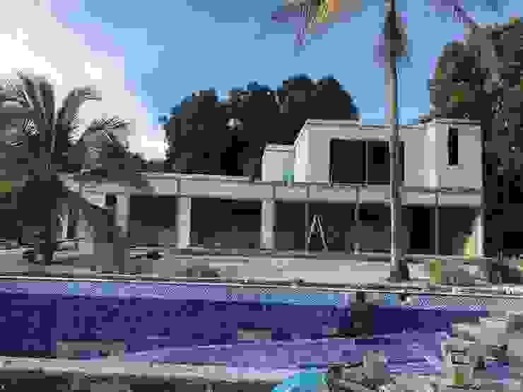 Construcción de Casa Prefabricada y Piscina privada de Salto Inmobiliario Moderno