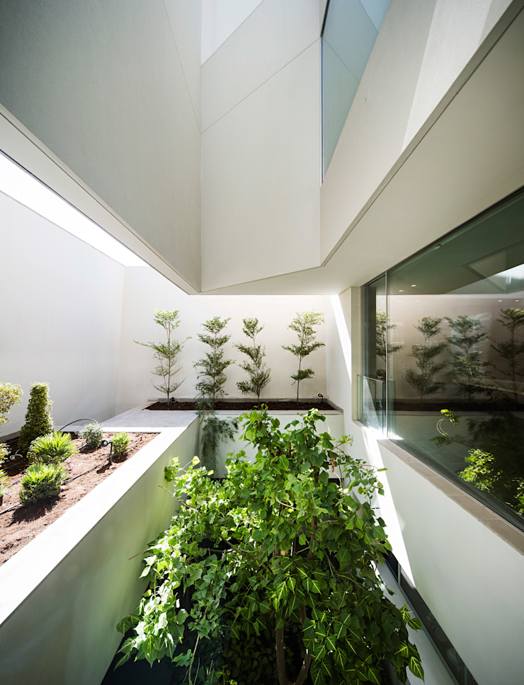 Modern style conservatory by AGi architects arquitectos y diseñadores en Madrid Modern Glass