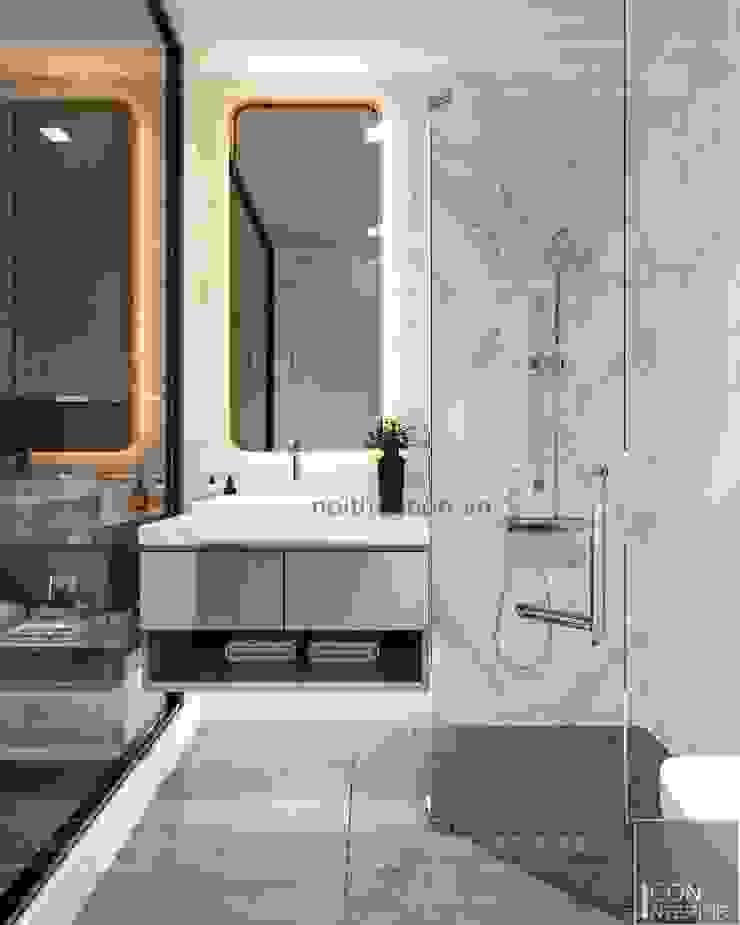 THIẾT KẾ NỘI THẤT CĂN HỘ VINHOMES GOLDEN RIVER – Tách Capuchino ấm áp Phòng tắm phong cách hiện đại bởi ICON INTERIOR Hiện đại