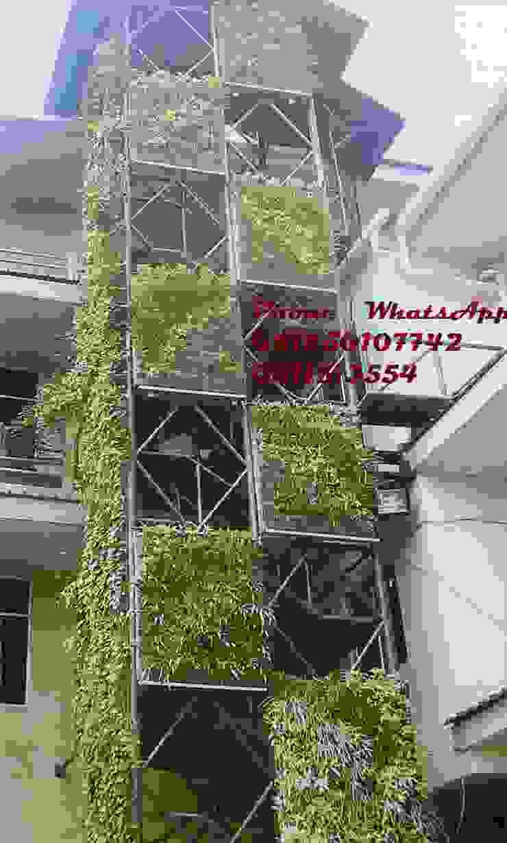 Taman vertikal untuk gedung dan kantor Oleh TUKANG TAMAN SURABAYA - jasataman.co.id Tropis
