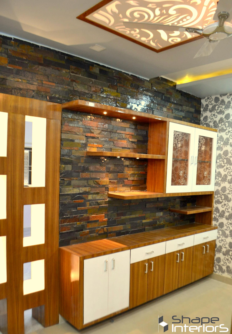 Wall unit with stone cladding Shape Interiors Living roomCupboards & sideboards