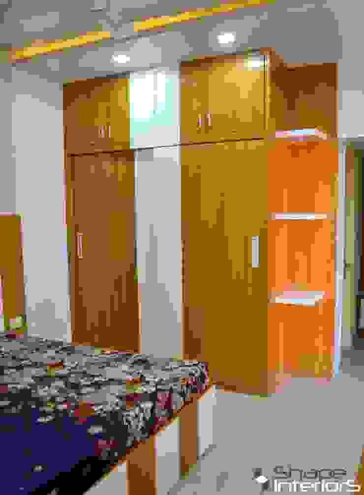 Long closet with slider doors Shape Interiors BedroomWardrobes & closets