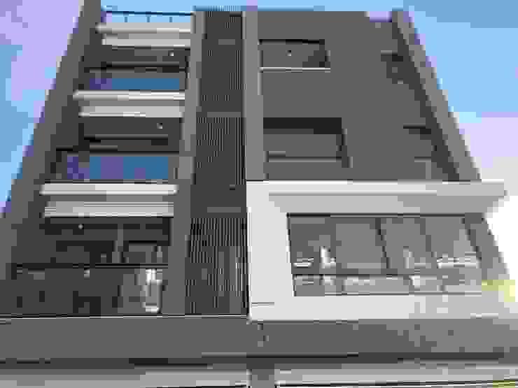 獨棟別墅住宅 根據 讚基營造有限公司 現代風 磚塊