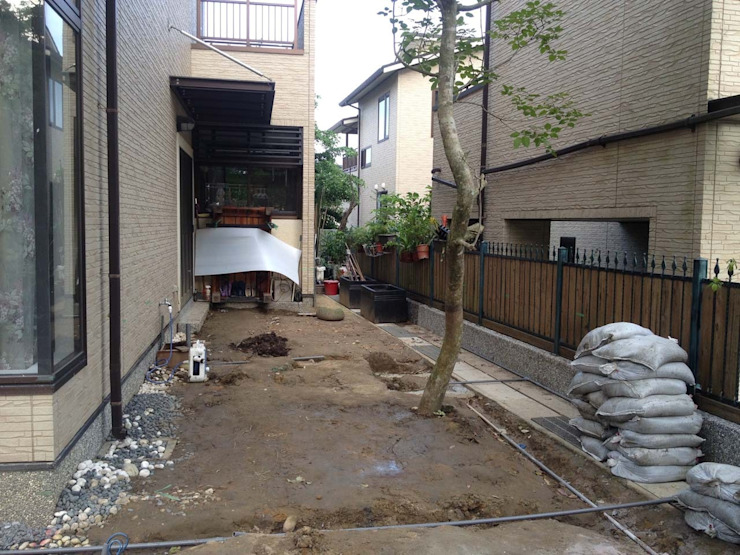 Jardines de piedra de estilo  por 大地工房景觀公司,