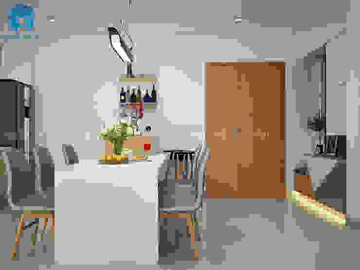 Phòng bếp không bị choáng chỗ khi đặt bộ bàn ghế gỗ hình chữ nhật có gam màu trắng - xám Phòng ăn phong cách hiện đại bởi Công ty TNHH Nội Thất Mạnh Hệ Hiện đại