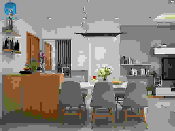 Phòng bếp không bị choáng chỗ khi đặt bộ bàn ghế gỗ hình chữ nhật có gam màu trắng - xám, tạo nên sự thanh lịch cũng như sự sạch sẽ cho căn phòng Phòng ăn phong cách hiện đại bởi Công ty TNHH Nội Thất Mạnh Hệ Hiện đại