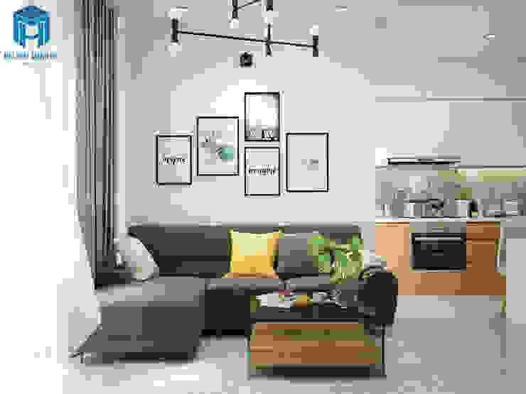 Phòng khách khá hài hòa với các gam màu sáng nhưng lại không hề mất đi nét sang trọng cùng sự ấm áp cần có của mỗi căn hộ bởi Công ty TNHH Nội Thất Mạnh Hệ Hiện đại