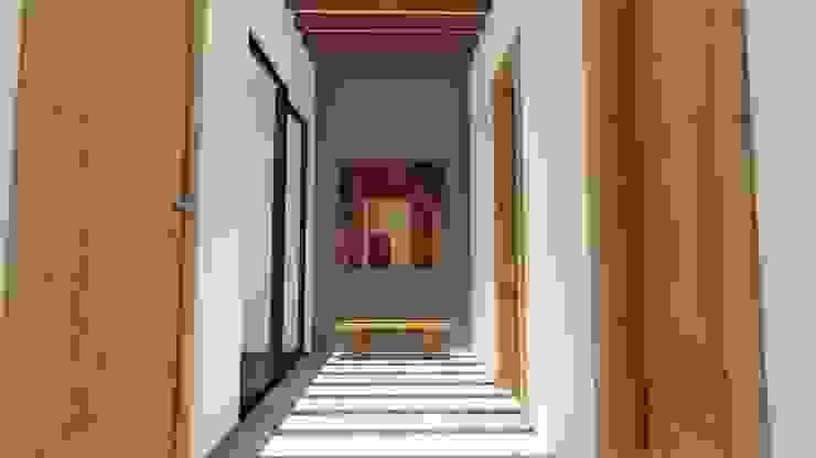 Eclectic style corridor, hallway & stairs by Taller de Materia Arquitectónica Eclectic