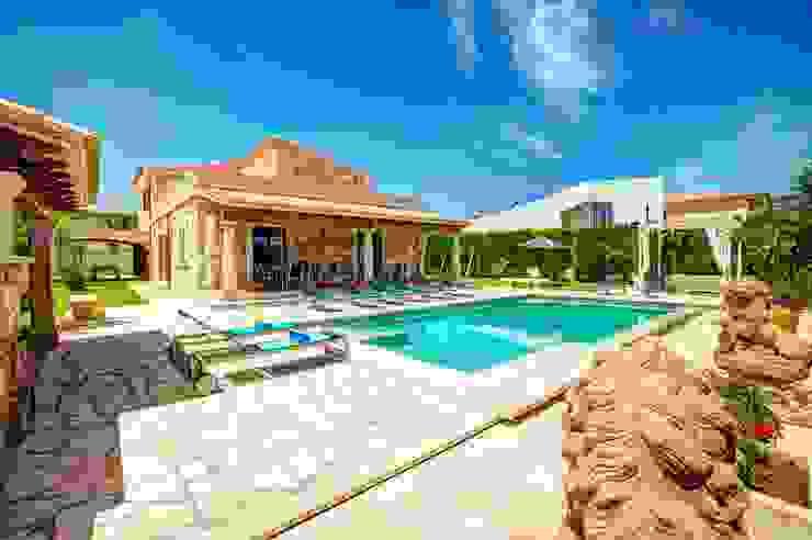 Diseño y construcción de una villa en Mallorca por Diego Cuttone de Diego Cuttone, arquitectos en Mallorca Mediterráneo Piedra
