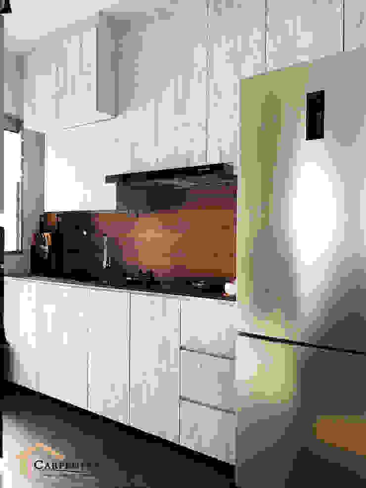 Contemporary style at Tenteram Peak Modern kitchen by Singapore Carpentry Interior Design Pte Ltd Modern