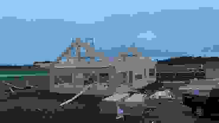 Casa en Uruguay (Construcción en 15 días) Superficie cubierta de 130 m2 de Patagonia Log Homes - Arquitectos - Neuquén Clásico Madera maciza Multicolor