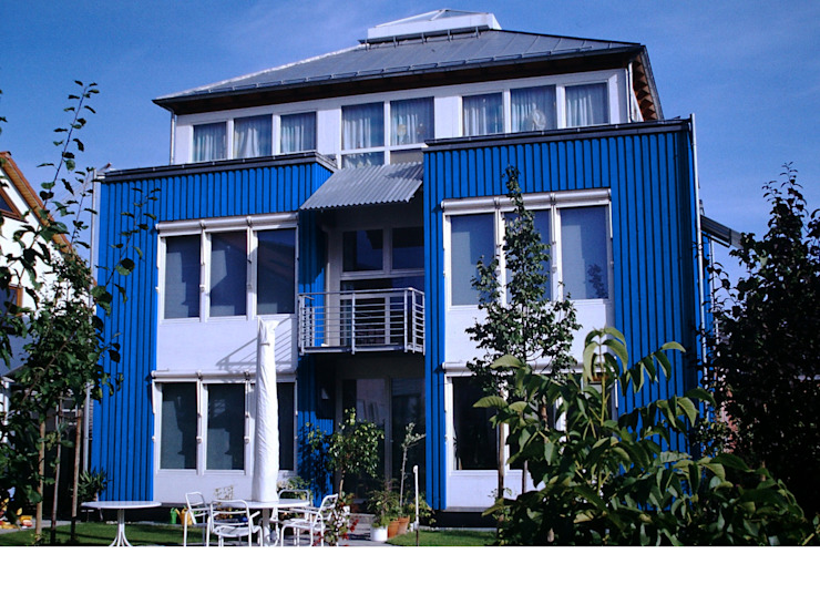 Junker Architekten Modern houses Wood Blue