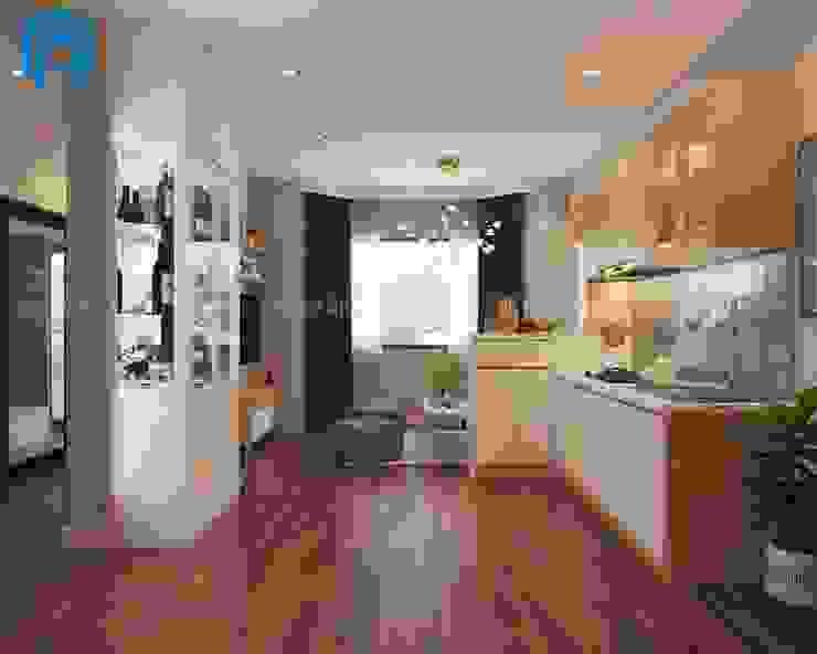 Nội thất của phòng khách và phòng bếp nhìn từ phía ngoài vào bởi Công ty TNHH Nội Thất Mạnh Hệ Hiện đại