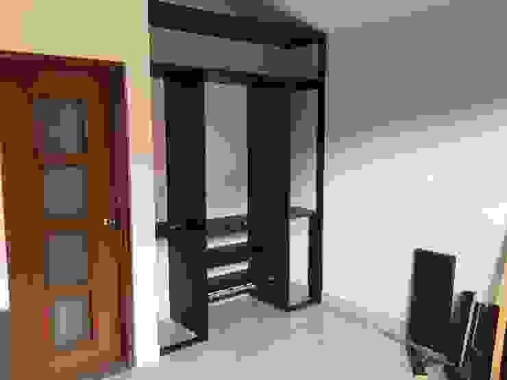 ARDI Arquitectura y servicios Closets de estilo moderno Aglomerado Marrón