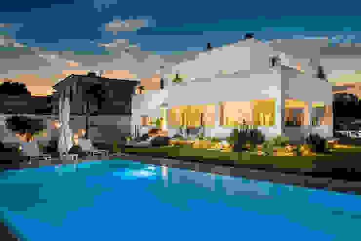 Villa Passariello Piscina moderna di manuarino architettura design comunicazione Moderno