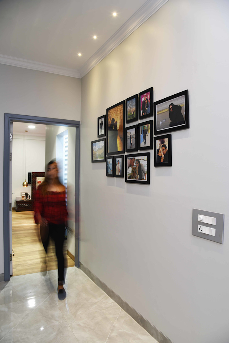 Picture wall- Apartment on Golf course extension road, Gurugram The Workroom Modern corridor, hallway & stairs