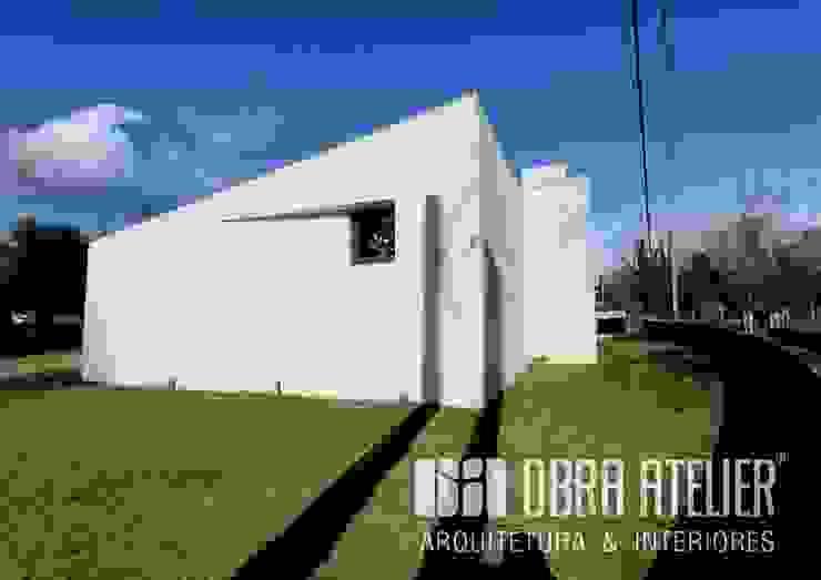 Lado exterior | Esquerdo por OBRA ATELIER - Arquitetura & Interiores Campestre
