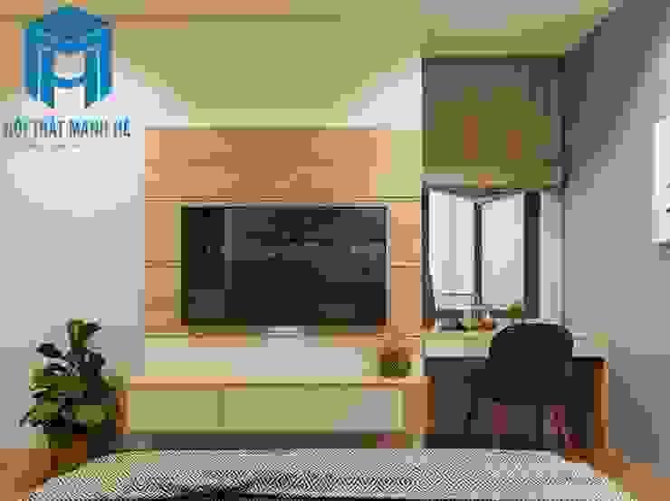 Kệ tivi treo tường có các ngăn đựng đồ khá tiện ích, bên cạnh đó bàn làm việc được đặt ngay cạnh cửa sổ khá hợp lý Phòng ngủ phong cách hiện đại bởi Công ty TNHH Nội Thất Mạnh Hệ Hiện đại