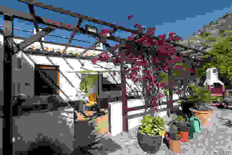 Terraza delantera Home & Haus | Home Staging & Fotografía Balcones y terrazas de estilo rústico