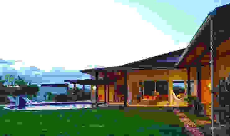 Casa de Campo Varandas, alpendres e terraços modernos por Arquitetura Sônia Beltrão & associados Moderno Madeira Efeito de madeira