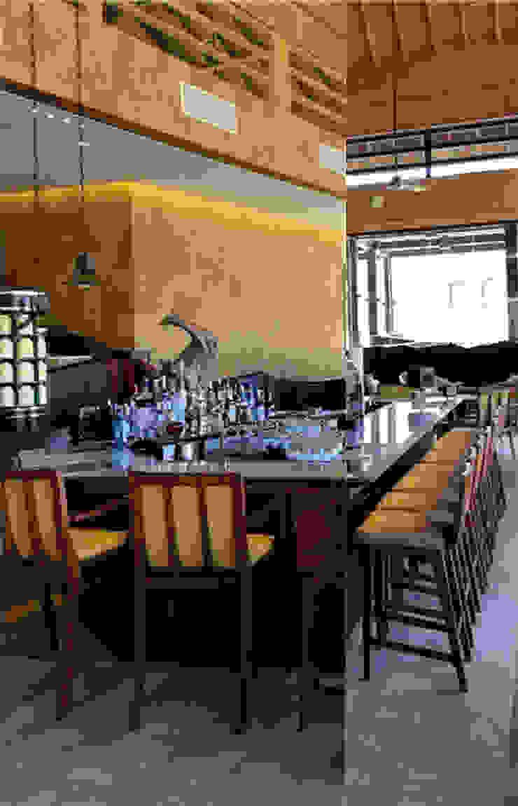 Ritz Carlton Bali, custom chairs, lounge and bar area Ruang Penyimpanan Wine/Anggur Tropis Oleh Sweden studio Tropis Kayu Wood effect