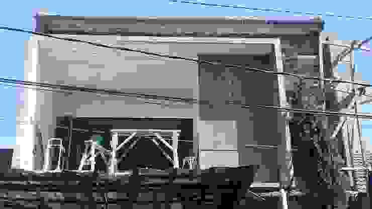Fasad depan Oleh Koloni Tri Arsitama