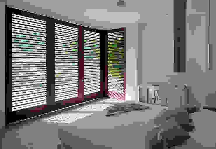 NOAH Proyectos SAS Camera da letto moderna Cemento Bianco