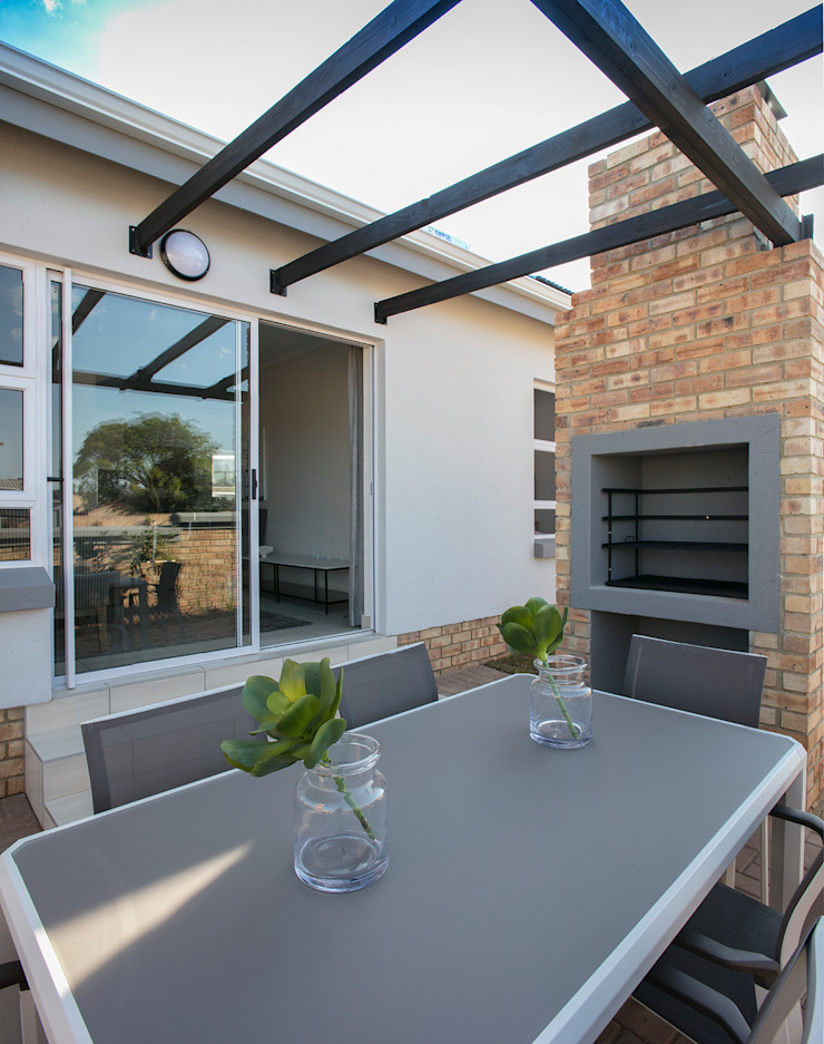 Spegash Interiors Moderner Balkon, Veranda & Terrasse