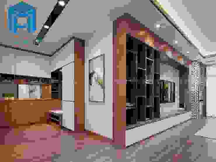 Hệ thống tủ, kệ gỗ tự nhiên nơi phòng khách bởi Công ty TNHH Nội Thất Mạnh Hệ Hiện đại
