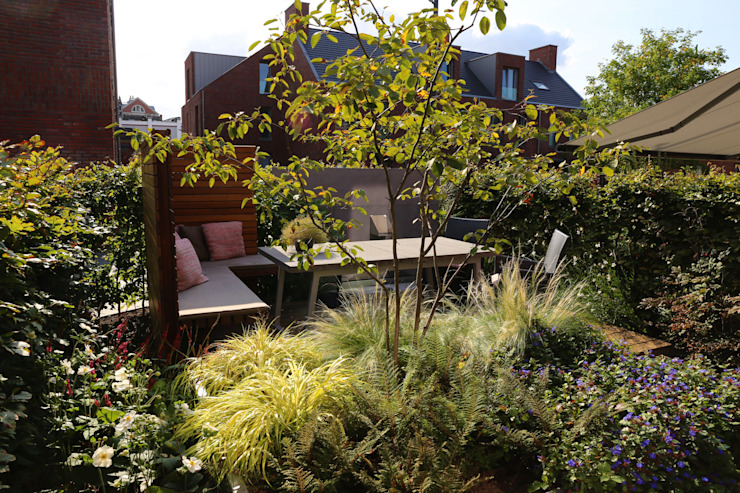 Jardins modernos por Hoveniersbedrijf Guy Wolfs Moderno