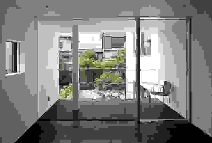 主寝室 モダンスタイルの寝室 の 松岡淳建築設計事務所 モダン