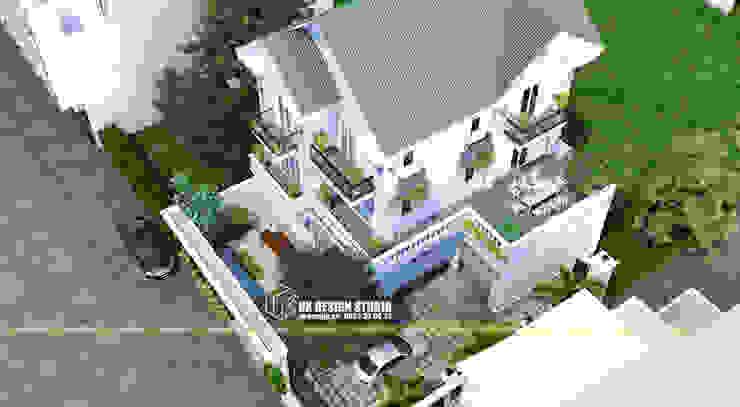 Biệt thự mái thái bởi UK DESIGN STUDIO - KIẾN TRÚC UK Nhiệt đới