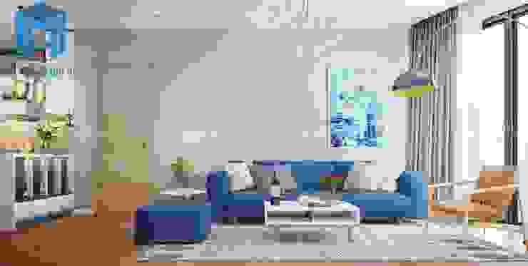 Bộ ghế sofa nệm chân gỗ màu xanh được đặt ngay trung tâm phòng khách bởi Công ty TNHH Nội Thất Mạnh Hệ Hiện đại