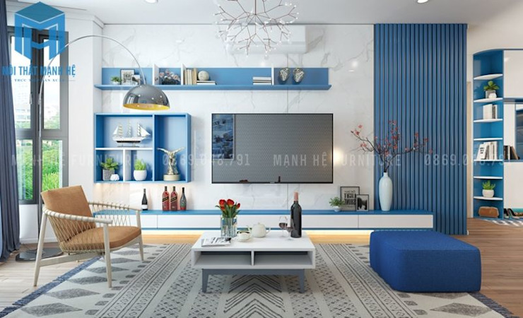 Tủ, kệ ti vi được lắp đặt trên tường phòng khách khá hiện đại và có tính hệ thống với nhau bởi Công ty TNHH Nội Thất Mạnh Hệ Hiện đại